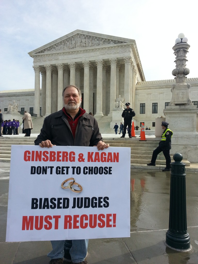 "Dr. Scott Lively at the United States Supreme Court.  The sign demands the recusal of Justices Ginsberg and Kagan, both of whom have officiated at same-sex ""weddings"" and thus proven themselves incapable of impartiality on the ""gay marriage"" question that is before the court."